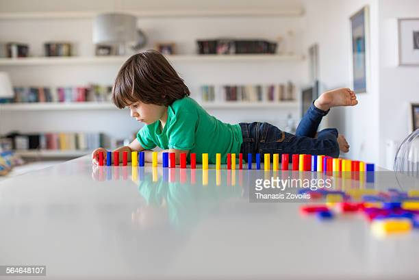 Small boy playing on a table