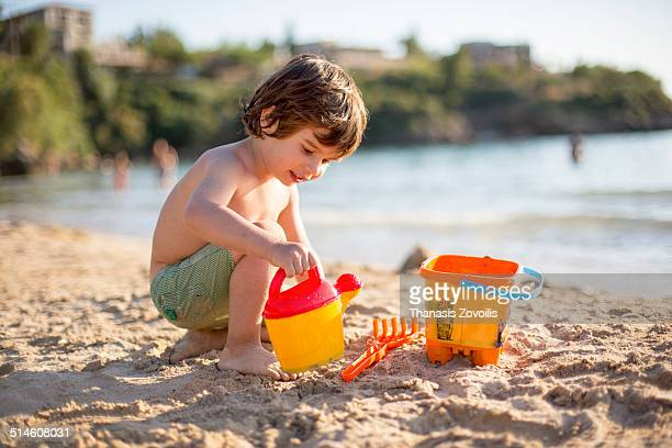 Small boy playing on the beach