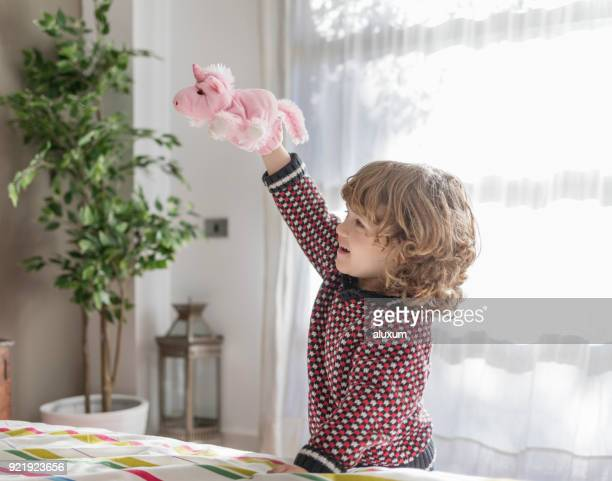 small boy playing with hand puppet at home - puppet stock pictures, royalty-free photos & images