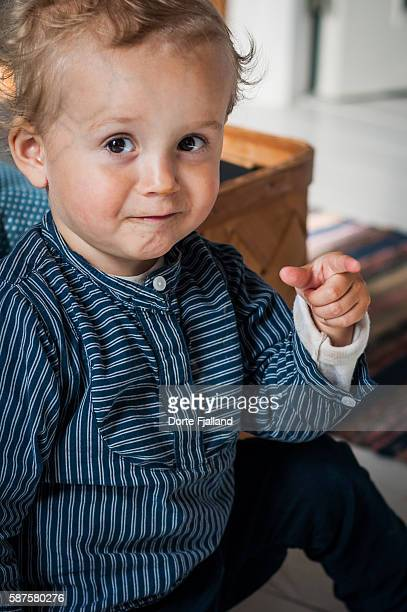 Small boy pointing finger
