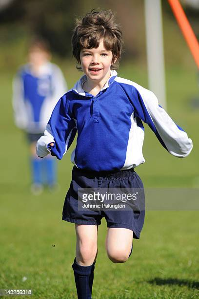 Small boy running in sports kit