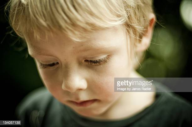 small boy sad - disappointment stock pictures, royalty-free photos & images