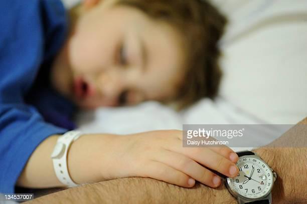 Small boy sleeping in hospital