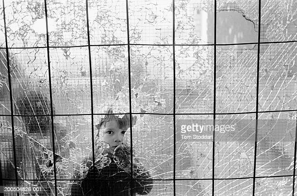 Bosnia Sarajevo July 1992 A small boy stares through a bullet riddled window in the Dobrinja suburb of Sarajevo During the 47 months between the...