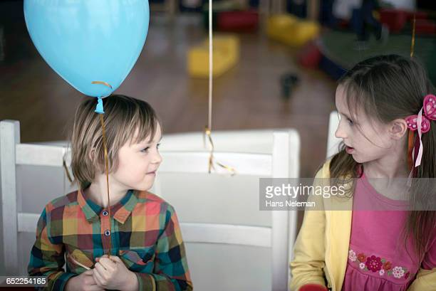 Small boy talking to his friend