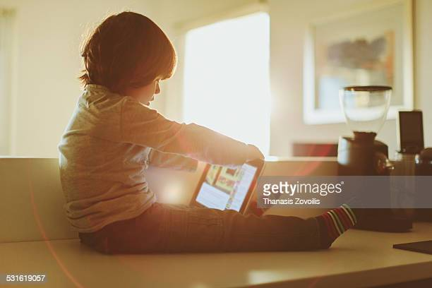 Small boy using a digital tablet