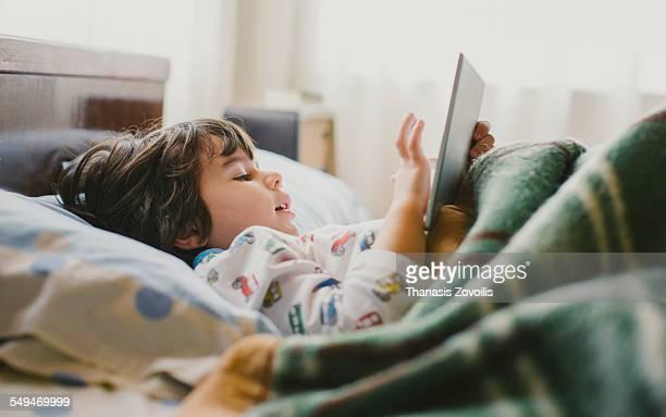 Small boy using a digital tablet