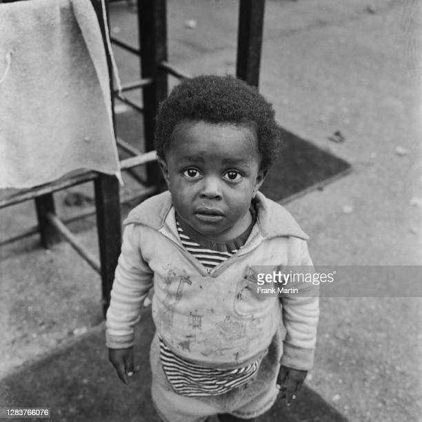 Small boy with a tear-stained face at a day nursery in the Notting Hill area of west London, circa 1958.