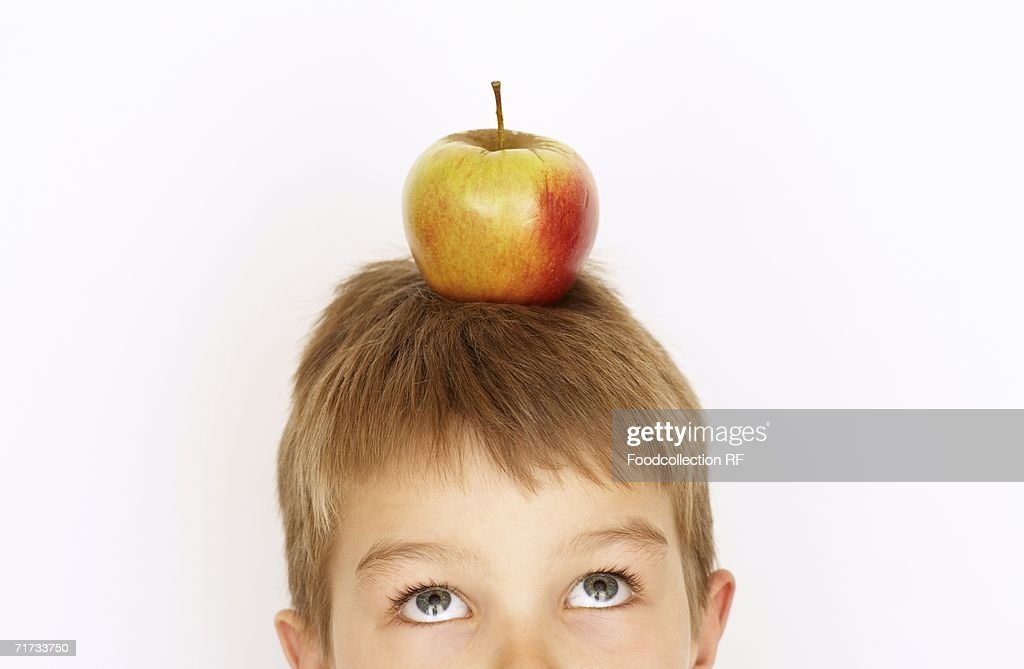 Small boy with apple on his head : Stock Photo