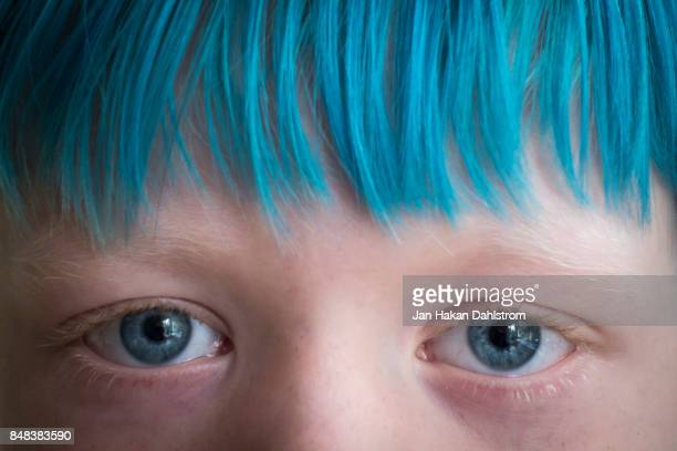 Small boy with blue hair