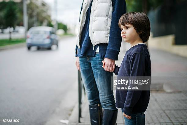 Small boy with his mother outdoor