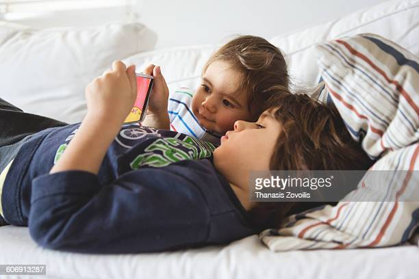 Small boys looking a smartphone