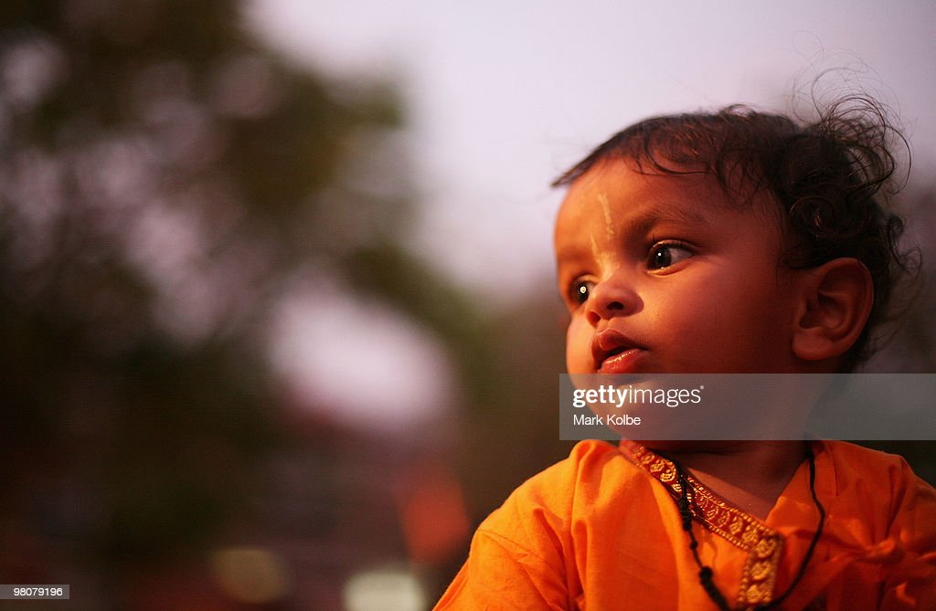 A small boys watches on as locals of Chandigarh take to the the street as they celebrate Ram Navmi religious festival on March 25 2010 in Chandigarh..