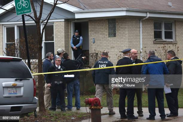 A small brick house at the corner of Grand Avenue and Melvina Avenue in Chicago is the scene of a shooting that involved ICE officer on Monday March...