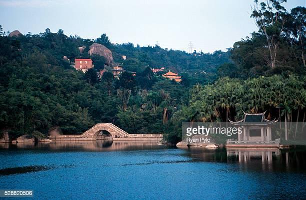 Small bridge on a lake inside the botanical garden near the Nanputuo Temple in Xiamen. The Nanputuo Temple is located on the southeast of Xiamen...