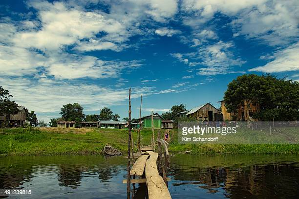 Small bridge over the river leads to a small village in the Amazon jungle in Colombia.