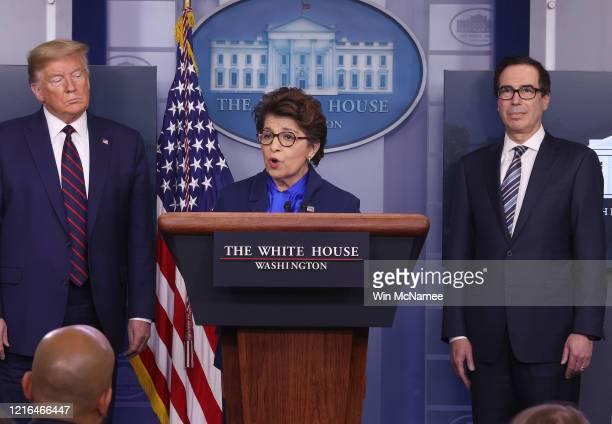 Small Business Administrator, Jovita Carranza speaks while flanked by U.S. President Donald Trump and Secretary of Treasury Steve Mnuchin in the...