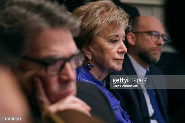 Small Business Administrator Linda McMahon listens to U.S. President Donald Trump talk to reporters during a cabinet meeting in the Cabinet Room at...
