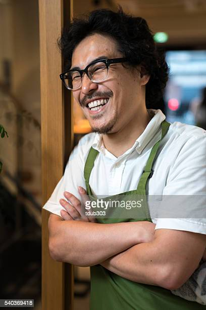 small business cafe owner greeting customers - lypsekyo16 stock pictures, royalty-free photos & images