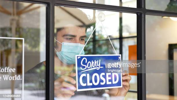small business closing during covid-19 pandemic - closing stock pictures, royalty-free photos & images