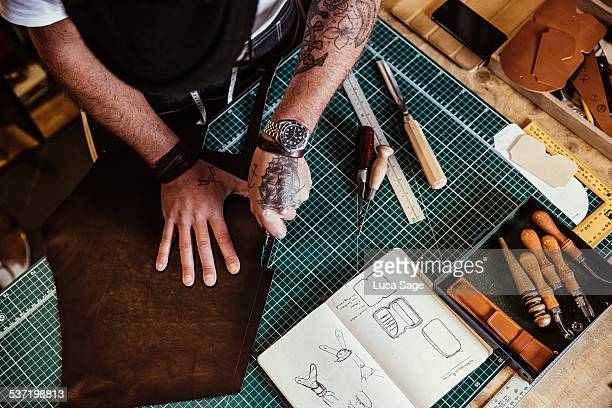 small business craftsman at work - leather stock pictures, royalty-free photos & images