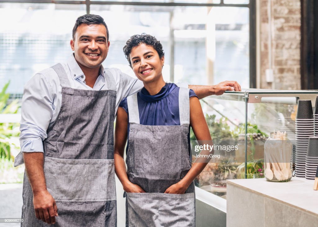 Small business entrepreneurs at their cafe : Stock Photo