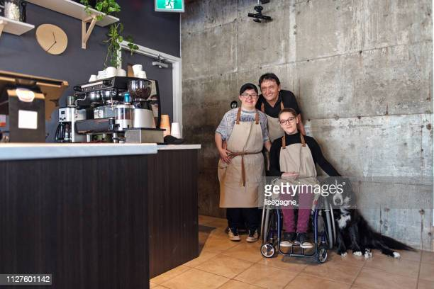 small business family created for disable people - social issues stock pictures, royalty-free photos & images