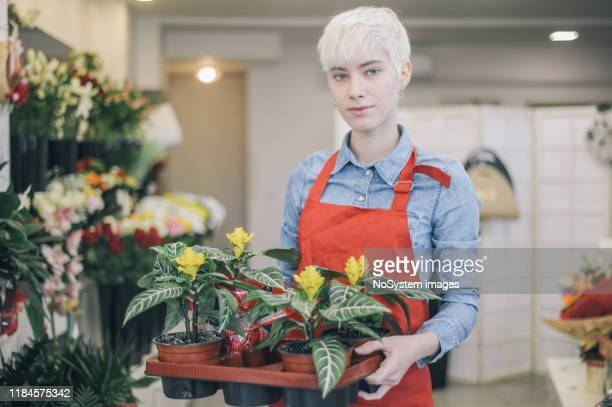 small business flower shop - gender fluid stock pictures, royalty-free photos & images
