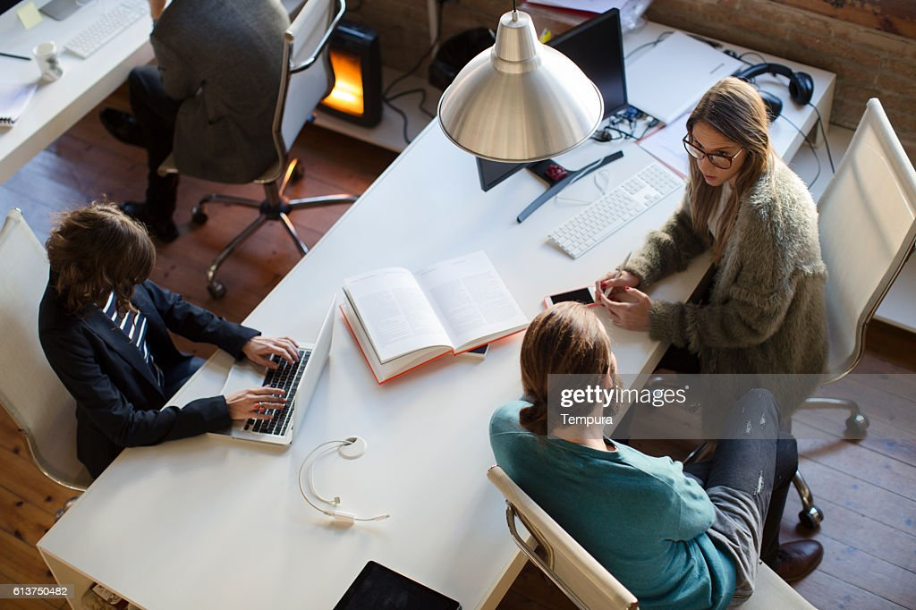 Small business meeting in a creative office. : Stock Photo