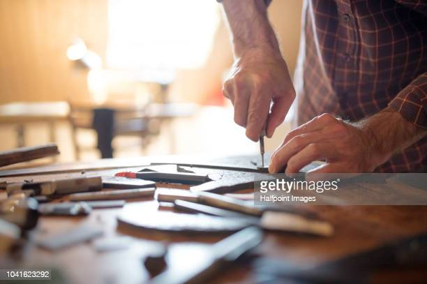 a small business of a craftsman making leather and canvas bags. - craft product stock pictures, royalty-free photos & images