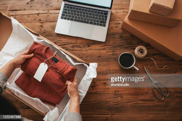 small business owener stock photo - clothing stock pictures, royalty-free photos & images
