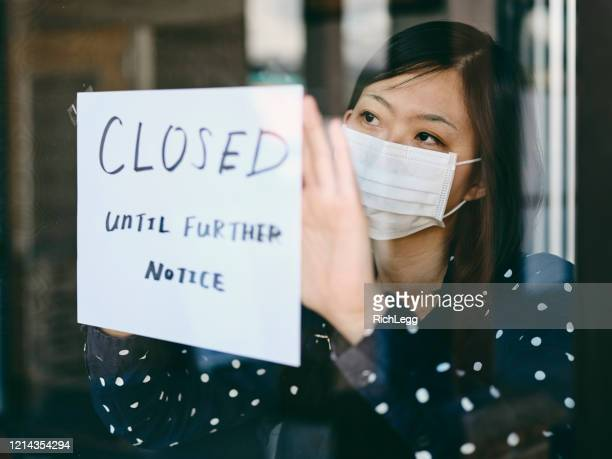 small business owner affected by covid-19 - coronavirus stock pictures, royalty-free photos & images