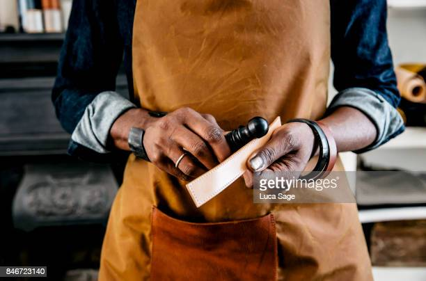 small business owner at work - leather stock pictures, royalty-free photos & images