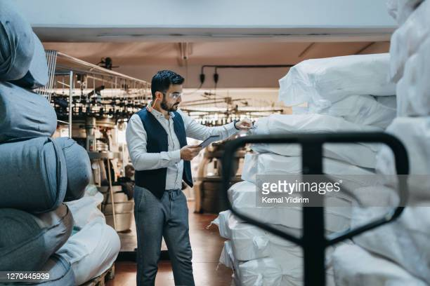 small business owner checking the serial numbers of the products - middle east stock pictures, royalty-free photos & images