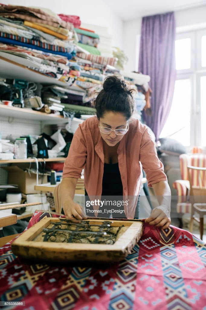 Small Business Owner Delicately Reupholstering An Old Chair : Stock Photo