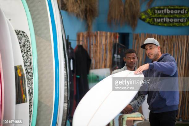 Small business owner doing sales in his surf shop
