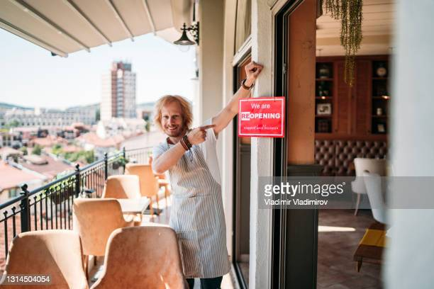 small business owner happy to open his restaurant - opening event stock pictures, royalty-free photos & images