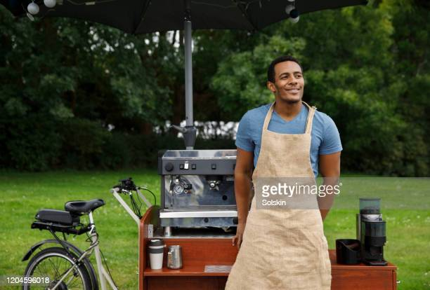small business owner in front of coffee bike shop