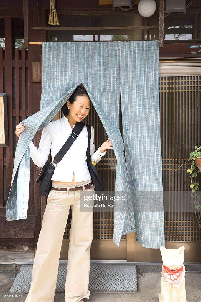 small business owner in front of her coffee shop ストックフォト
