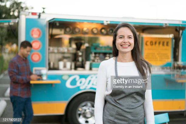 small business owner in front of her food truck - small business stock pictures, royalty-free photos & images