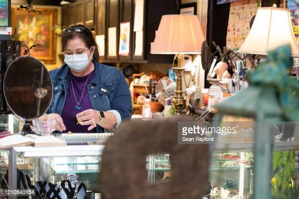 Small business owner Lannie Lewis works in her retail shop, the State Street Trading Company, on April 23, 2020 in West Columbia, South Carolina....