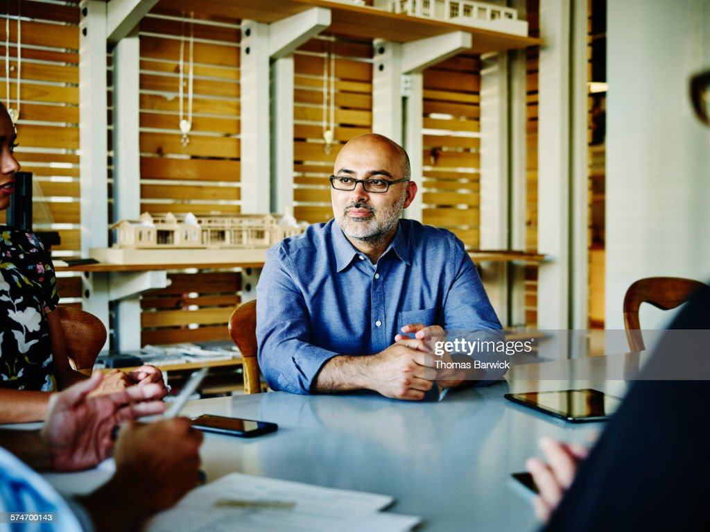 Small business owner listening during meeting : Stock Photo