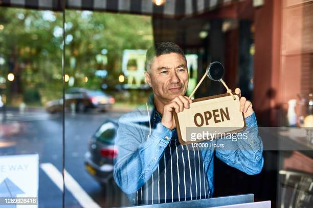 small business owner opening restaurant - open stock pictures, royalty-free photos & images