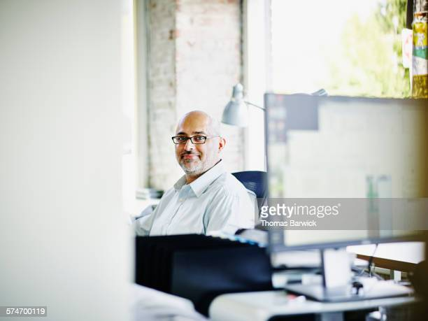 Small business owner sitting at workstation