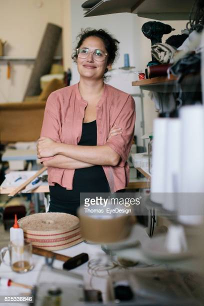 Small Business Owner Standing In Workshop, Smiling.