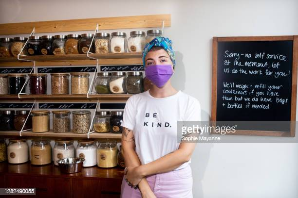 a small business owner stood proudly inside her whole foods refill shop - environmentalist stock pictures, royalty-free photos & images