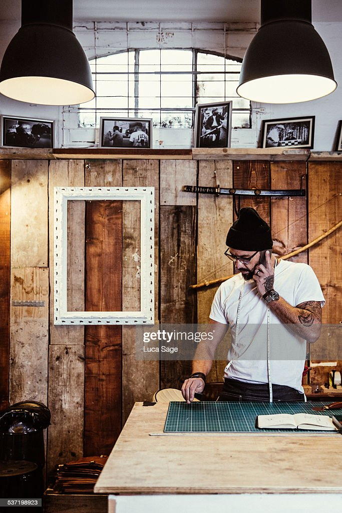 Small Business owner takes a call : Stock Photo