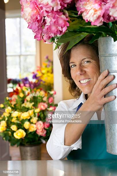 small business owner/florist in shop - blacksburg stock pictures, royalty-free photos & images