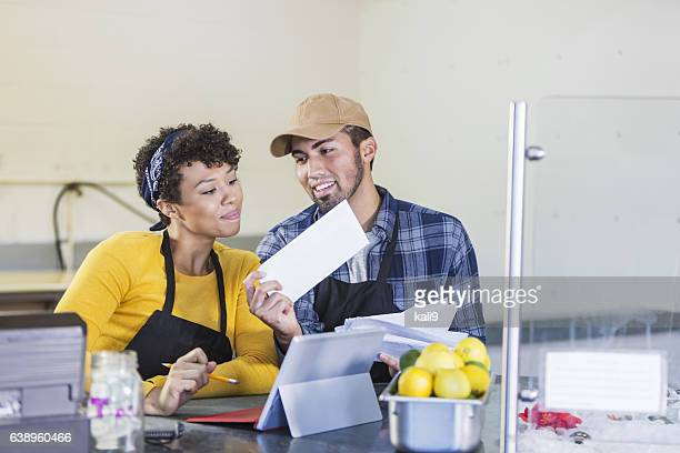 Small business owners, paying bills