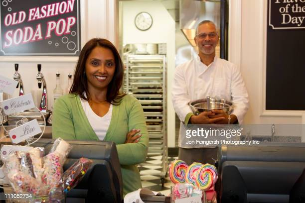 Small business owners standing in bakery shop